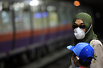 An Egyptians wear a face mask at the train station  in Cairo, the capital of Egypt on June 14, 2009.  Egypt, hard hit by the more deadly H5N1 bird flu virus, detected its first H1N1 case early this month in a 12-year-old American girl who arrived for a holiday in the most populous Arab country. To date, 18 cases of H1N1, formerly known as swine flu, have been reported in the country. Photo by Wissam Nassar.