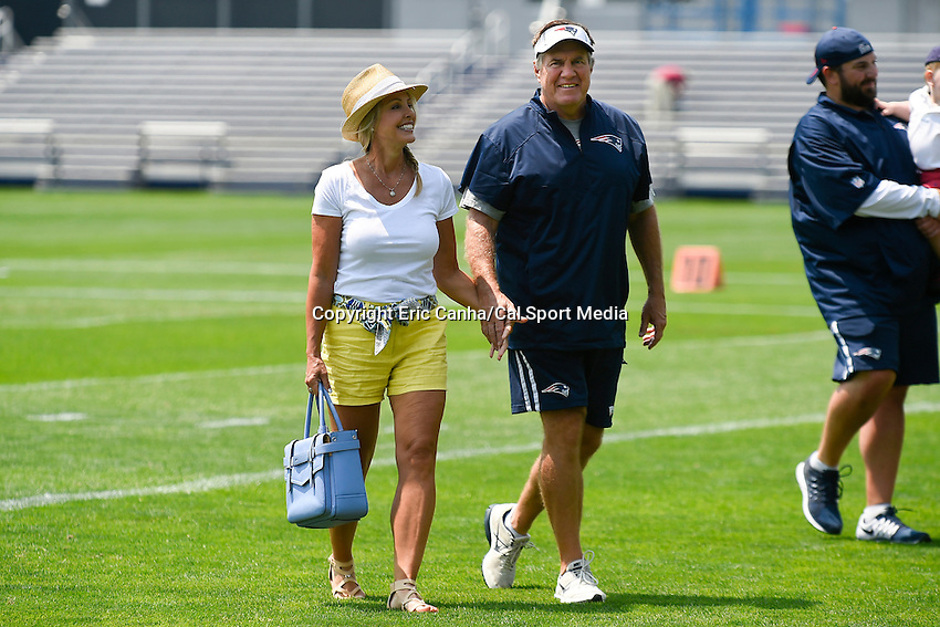 July 25, 2014 - Foxborough, Massachusetts, U.S.- New England Patriots head coach Bill Belichick walks off the field with girlfriend Linda Holliday at the New England Patriots training camp held at Gillette Stadium in Foxborough Massachusetts.  Eric Canha/CSM
