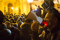 Demonstrator speaks into a loudspeaker during a clash with a line of police during a protest against government corruption in front of the building of the Hungarian Parliament in Budapest, Hungary on November 17, 2014. ATTILA VOLGYI