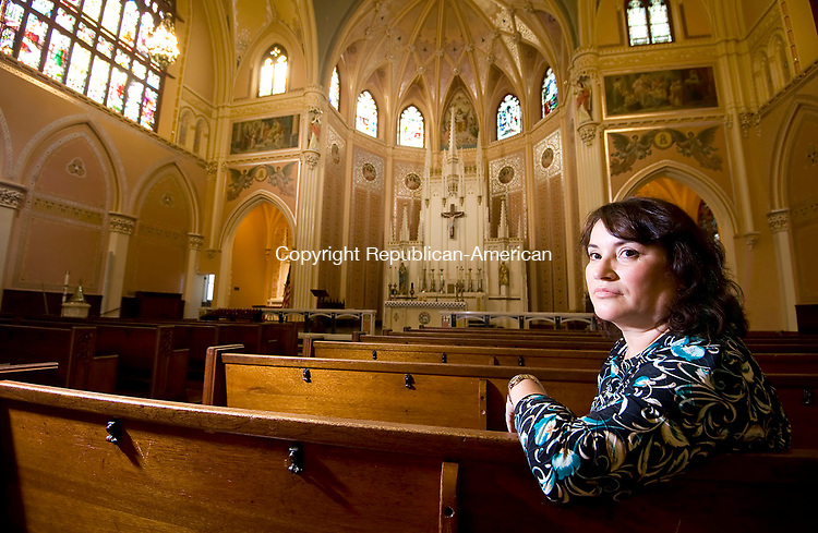 WATERBURY, CT-091517JS04-- Ana Crepo, a secretary at Sacred Heart Church in Waterbury, sits inside the Shrine of St. Anne Church in Waterbury. With the blending of several Catholic Churches into St. Anne's Crepo's position is in doubt, Jim Shannon Republican-American