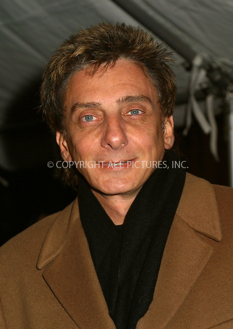 """Singer Barry Manilow arrives at the special gala performance of """"La Boheme's"""" to benefit Robin Hood Foundation, the charity organization commited to fighting poverty in New York City. New York, December 3, 2002. Please byline: Alecsey Boldeskul/NY Photo Press.   ..*PAY-PER-USE*      ....NY Photo Press:  ..phone (646) 267-6913;   ..e-mail: info@nyphotopress.com"""