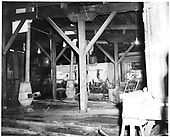 Interior of Durango roundhouse.  D&amp;RGW #473 K-28 is in background with boiler lagging.<br /> D&amp;RGW  Durango, CO  Taken by Payne, Andy M. - 4/8/1968