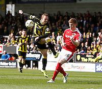 Burton Albion v Barnsley 16.4.16 .Sky Bet League 1 ....... Burtons Stuart Beavon sees his shot blocked by Alfie Mawson