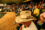 This essay documents the proceedings over two nights at the Birdsville Races, a small country town in South Western Queensland..Fred Brophy owns the last boxing tent to tour Australia. His tent and his troupe of boxers have toured Australia for the past 75years, mainly in country towns of Queensland and South Australia where the boxers are challenged by locals in the boxing tent arena. Women are also welcome to show there skills in the boxing tent, even though female boxing is banned most Australian states. Sadly, health and safety restrictions are putting pressure on the troupe making it much harder to continue despite it's huge popularity. .