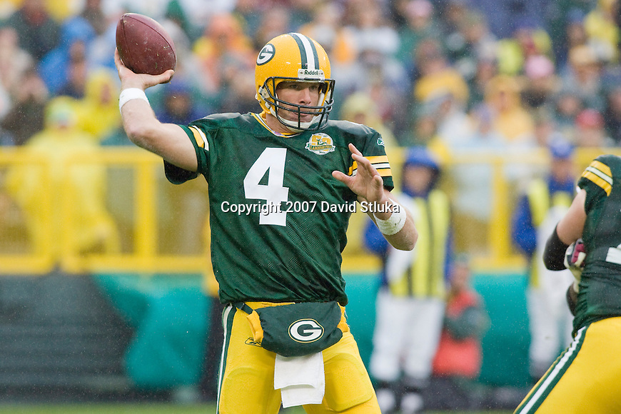Quarterback Brett Favre #4 of the Green Bay Packers throws a pass during an NFL football game against the Washington Redskins on October 14, 2007 in Green Bay, Wisconsin. The Packers beat the Redskins 17-14. (Photo by David Stluka)