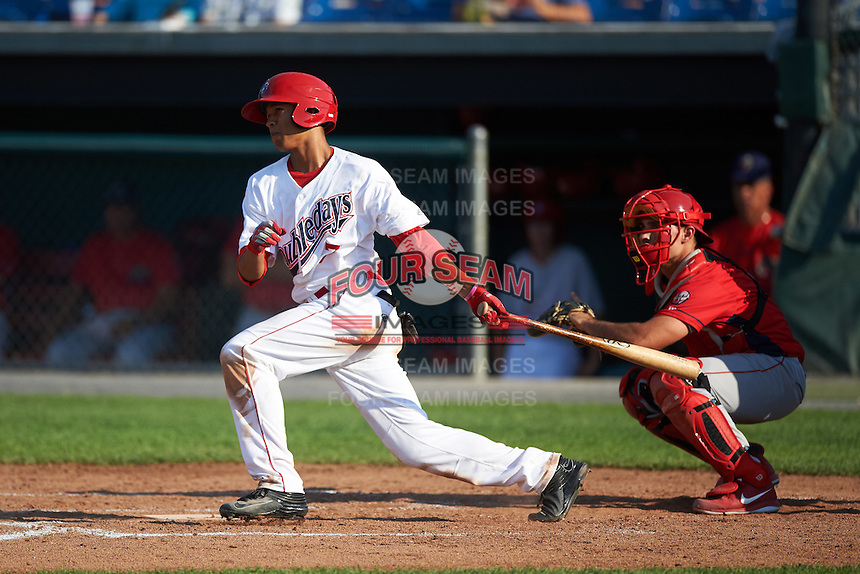 Auburn Doubledays center fielder Blake Perkins (7) at bat in front of catcher Brett Barbier during a game against the Williamsport Crosscutters on June 26, 2016 at Falcon Park in Auburn, New York.  Auburn defeated Williamsport 3-1.  (Mike Janes/Four Seam Images)