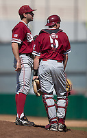 LOS ANGELES, CA - April 10, 2011: Pitcher Danny Sandbrink of Stanford baseball talks to catcher Zach Jones during a break for an umpire conference during Stanford's game against USC at Dedeaux Field in Los Angeles. Stanford lost 6-2.