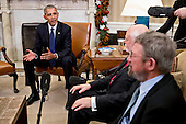 U.S. President Barack Obama, left, speaks as he meets with the 2016 American Nobel Prize laureates including J. Fraser Stoddart, professor at Northwestern University and laureate of the 2016 Nobel Prize in chemistry, center, and J. Michael Kosterlitz, professor at Brown University and laureate of the 2016 Nobel Prize in physics, right, in the Oval Office of the White House in Washington, D.C., U.S., on Wednesday, Nov. 30, 2016. Annual prizes for achievements in physics, chemistry, medicine, peace and literature were established in the will of Alfred Nobel, the Swedish inventor of dynamite, who died in 1896. <br /> Credit: Andrew Harrer / Pool via CNP
