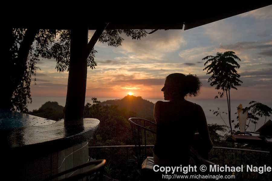 MANUEL ANTONIO, COSTA RICA- JANUARY 11, 2009: A woman watches the sunset from the La Mariposa Hotel on January 11, 2009 in Manuel Antonio, Costa Rica.    (Photo by Michael Nagle)
