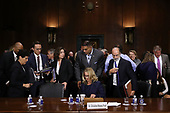 WASHINGTON, DC - SEPTEMBER 27:  Christine Blasey Ford (C) takes a break while testifying before the Senate Judiciary Committee in the Dirksen Senate Office Building on Capitol Hill September 27, 2018 in Washington, DC. A professor at Palo Alto University and a research psychologist at the Stanford University School of Medicine, Ford has accused Supreme Court nominee Judge Brett Kavanaugh of sexually assaulting her during a party in 1982 when they were high school students in suburban Maryland.  (Photo by Win McNamee/Getty Images)