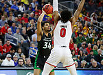 SIOUX FALLS, SD - MARCH 8: De'Sean Allen-Eikens #34 of the North Dakota Fighting Hawks looks for an open teammate past Stanley Umude #0 of the South Dakota Coyotes at the 2020 Summit League Basketball Championship in Sioux Falls, SD. (Photo by Richard Carlson/Inertia)