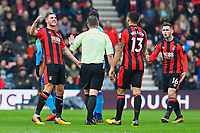 Dan Gosling of AFC Bournemouth left and Jermain Defoe of AFC Bournemouth right dispute a call by Referee Kevin Friend  during AFC Bournemouth vs Arsenal, Premier League Football at the Vitality Stadium on 14th January 2018