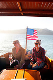 USA, California, San Francisco, two women sit on the back of a restored 1927 Stevens on the San Francisco Bay, Tiburon