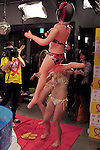 """A Japanese adult movie actress plays with a sexy balloon doll during the 24 hour telethon event with the aim of raising money for a Stop AIDS charity on August 31, 2014 in Tokyo, Japan. The adult movie stars allowed fans to feel their breasts in return for a donation to the AIDS charity. The 12th annual 24 hour TV event """"Eroticism Saves the Earth Telethon"""" is organized by Sky Perfect Tv Adult Chanel with motto """"Social contribution while enjoying the erotic"""". Fans are given the chance to interact with some of the channels leading actresses in the live broadcast event that runs from Saturday afternoon through until Sunday 20:00 hrs. The organizers expect to attract around 2000 fans raising JPY 2 million (US$20, 000) over the weekend. (Photo by Rodrigo Reyes Marin/AFLO)"""