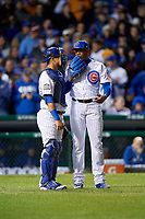 Chicago Cubs pitcher Aroldis Chapman (54) talks with Willson Contreras (40) in the eighth inning during Game 5 of the Major League Baseball World Series against the Cleveland Indians on October 30, 2016 at Wrigley Field in Chicago, Illinois.  (Mike Janes/Four Seam Images)