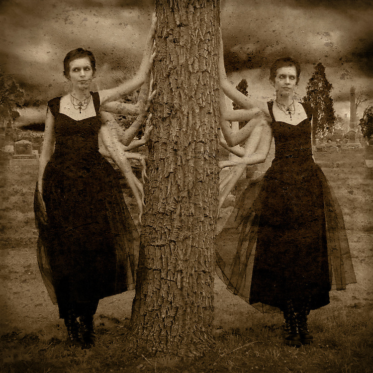 A conceptual image of a young woman with many arms leaning against a tree