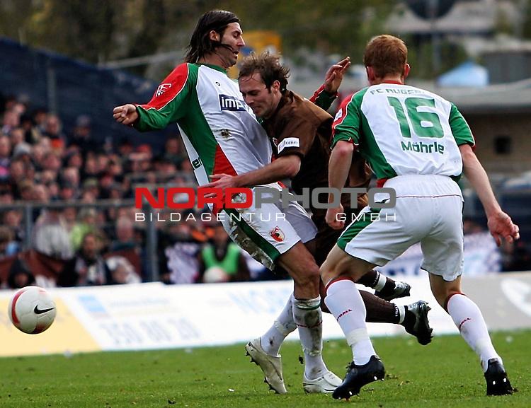 2.Liga 2007/2008  13. Spieltag Hinrunde<br /> FC St.Pauli &ndash; vs. FC Augsburg<br /> <br /> Augsburgs Roland Benschneider (Nr.21, links) kann Filip Trojan (Nr.6, Mitte) nur mit unfairen Mitteln stoppen. Vorne Augsburgs Uwe M&ouml;hrle (Nr. 16).<br /> <br /> <br /> Foto &copy; nph (nordphoto)<br /> <br /> *** Local Caption ***