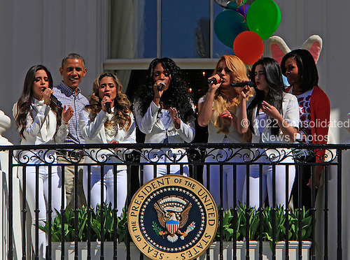 United States President Barack Obama and First Lady Michelle Obama  and the Fifth Harmony participate in the White House Easter Egg Roll on the South Lawn on April 6,2015.<br /> Credit: Dennis Brack / Pool via CNP