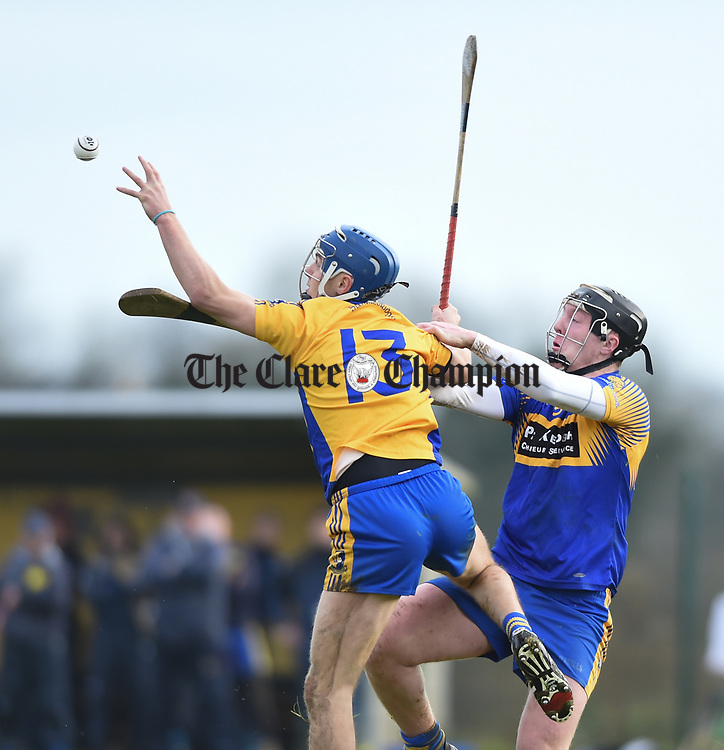 Brian Corry of  Sixmilebridge  in action against Liam O Connor of Newmarket during their Clare Champion Cup final at Clonlara. Photograph by John Kelly.