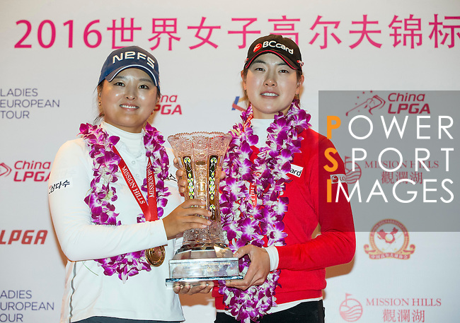 The winning team Jin Young Ko of South Korea (left) and Jung Min Lee of South Korea (right) pose with the trophy during the Prize giving ceremony of the World Ladies Championship 2016 on 13 March 2016 at Mission Hills Olazabal Golf Course in Dongguan, China. Photo by Victor Fraile / Power Sport Images