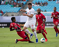 CHARLOTTE, NC - JUNE 23: Yosel Piedra #6 defends against Lucas Cavallini #19 during a game between Cuba and Canada at Bank of America Stadium on June 23, 2019 in Charlotte, North Carolina.