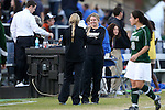 10 November 2012: Loyola Maryland assistant coach Emily Janss (center) talks with head coach Katherine Remy Vettori (left). The Duke University Blue Devils played the Loyola University Maryland Greyhounds at Koskinen Stadium in Durham, North Carolina in a 2012 NCAA Division I Women's Soccer Tournament First Round game. Duke won the game 6-0.