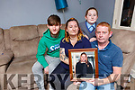 Tina  and Sean Kidney Kenmare holding a picture of their daughter Sasha with their children Chloe and Dyllian