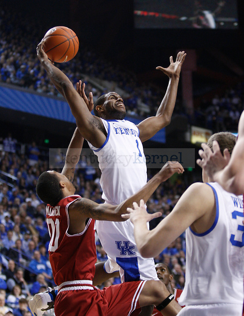 UK's Darius Miller grabs an offensive rebound against Arkansas at Rupp Arena on Tuesday, Jan. 17, 2012. Photo by Scott Hannigan | Staff