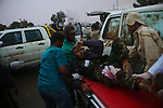 Sirte, LIBYA: Monday 11th October 2011:..A wounded rebel soldier is taken to an ambulance. Military gains came at a heavy price, with medics reporting 13 dead and 90 wounded on the western side of Sirte alone...Ayman Oghanna