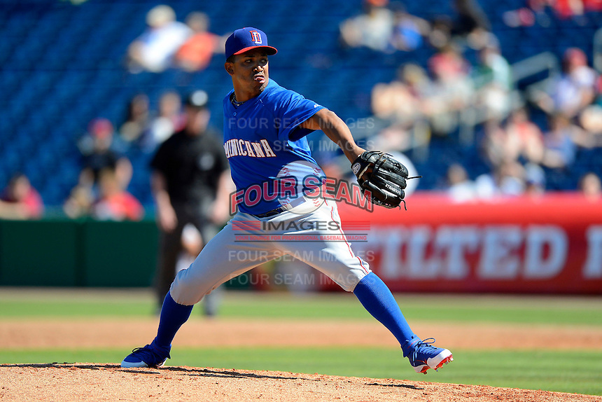 Dominican Republic pitcher Octavio Dotel #20 during a Spring Training game against the Philadelphia Phillies at Bright House Field on March 5, 2013 in Clearwater, Florida.  The Dominican defeated Philadelphia 15-2.  (Mike Janes/Four Seam Images)