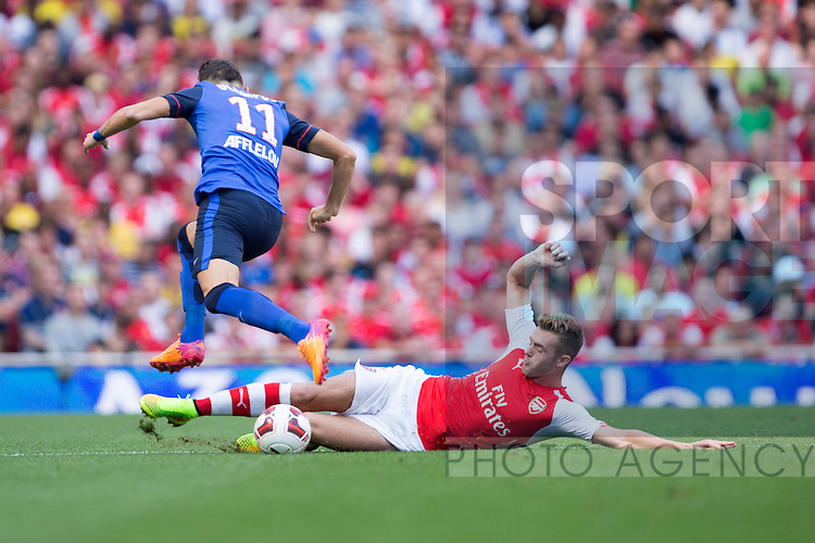 Arsenal's Calum Chambers challenges Lucas Ocampos of Monaco - Arsenal vs. Monaco - Emirates Cup - Emirates Stadium - London - 03/08/2014 Pic Philip Oldham/Sportimage