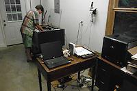 Zack Ellison (zgelaser@att.net) prepares a trophy for laser engraving