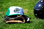 18 June 2010: A Vermont Lake Monsters cap and glove lies on the grass prior to a game against the Lowell Spinners at Centennial Field in Burlington, Vermont. The Lake Monsters defeated the Spinners 9-4 in the NY Penn League season home opener. Mandatory Credit: Ed Wolfstein Photo