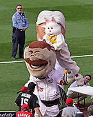 "The Easter Bunny goes airborne to push over ""Teddy Roosevelt"" during the President's Race between innings at the game where the New York Mets played against the Washington Nationals at Nationals Park in Washington, D.C. on Monday, April 6, 2015.<br /> Credit: Ron Sachs / CNP<br /> (RESTRICTION: NO New York or New Jersey Newspapers or newspapers within a 75 mile radius of New York City)"