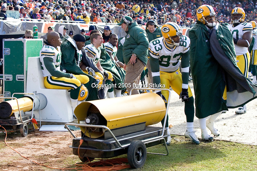 CHICAGO - DECEMBER 4: Players of the Green Bay Packers try to stay warm during the game against the Chicago Bears on December 4, 2005 at Soldier Field in Chicago, Illinois. The Bears defeated the Packers 19-7. (Photo by David Stluka)