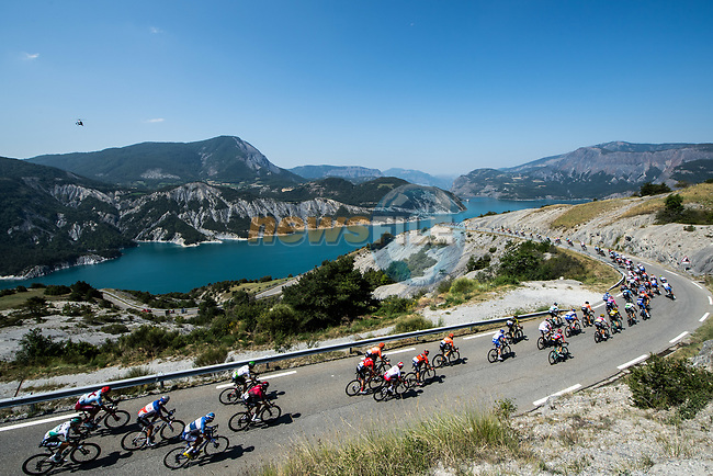 The peloton ride along the Lac de Serre-Ponçon during Stage 18 of the 2019 Tour de France running 208km from Embrun to Valloire, France. 25th July 2019.<br /> Picture: ASO/Alex Broadway | Cyclefile<br /> All photos usage must carry mandatory copyright credit (© Cyclefile | ASO/Alex Broadway)