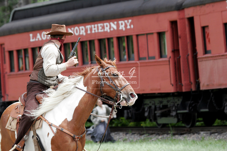 A cowboy bandit robbing an old steam train with a civilian girl trying to escape
