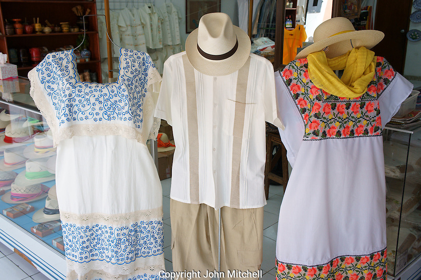 Yucatecan guayabera shirt and embroidered dresses in a store in Merida, Yucatan, Mexico.