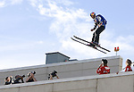 In this photo provided by the Reno Sparks Convention and Visitor's Authority, Miles Daisher performs an urban Ski-BASE jump off a ramp built on the roof of the Silver Legacy hotel casino in downtown Reno, Nev., Saturday Nov. 17, 2007. The stunt was to promote the local premier of the 2007 Warren Miller ski movie Playground and to raise money for the Make-a-Wish foundation, which helps make wishes come true for seriously ill children.(Reno Sparks Convention and Visitor's Authority)