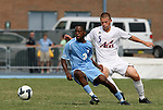 06 September 2009: UNC's Alex Dixon (3) and Evansville's Blake Schneider (5). The University of North Carolina Tar Heels defeated the Evansville University Purple Aces 4-0 at Fetzer Field in Chapel Hill, North Carolina in an NCAA Division I Men's college soccer game.