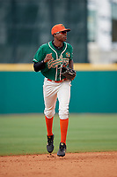 Greensboro Grasshoppers center fielder Thomas Jones (12) jogs back to the dugout in between innings during a game against the Lakewood BlueClaws on June 10, 2018 at First National Bank Field in Greensboro, North Carolina.  Lakewood defeated Greensboro 2-0.  (Mike Janes/Four Seam Images)