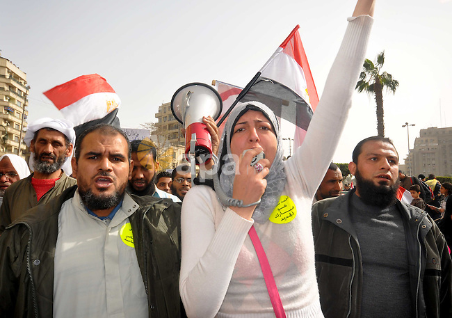 Egyptian protesters take part in a demonstration and Friday prayers in Tahrir Square, Cairo, Egypt, Friday, Feb. 25, 2011. Tens of thousands rallied in Cairo's Tahrir Square on Friday, trying to keep up pressure on Egypt's military rulers to carry out reforms and calling for the dismissal of holdovers from the regime of ousted President Hosni Mubarak. Photo by Ahmed Asad
