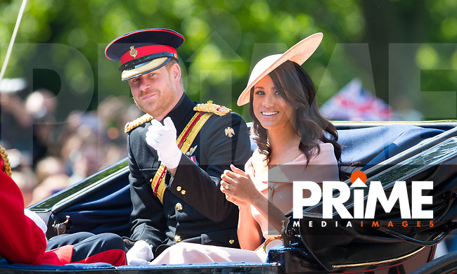 Prince Harry & Meghan Markle (Meghan, Duchess of Sussex) during Trooping the Colour - Queen Elizabeth II Birthday Parade 2018 at The Mall, Buckingham Palace, England on 9 June 2018. Photo by Andy Rowland.