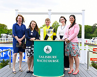 Jockey Jack Mitchell receives a trophy and Champagne from sponsors for winning The Smith & Williamson Fillies' Novice Stakes (Div 1)  during Afternoon Racing at Salisbury Racecourse on 16th May 2019