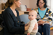 A mother gets advice at a breast-feeding clinic, Woodfield Road Medical Centre, Harrrow Road, London