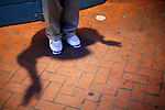 Shadow and feet of a street tap dancer in New Orleans Louisiana Friday Oct 24 2008. Americans will go to the polls on Nov 4, at a time of great Financial crisis, war in Iraq and Afghanistan, to elect a  new President. A vote, that will affect not only America, but the whole world. Photo by Eyal Warshavsky .