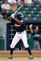 Derrick Robinson (9) of the Northwest Arkansas Naturals at bat during a game against the San Antonio Missions at Arvest Ballpark on June 30, 2011 in Springdale, Arkansas. (David Welker / Four Seam Images)
