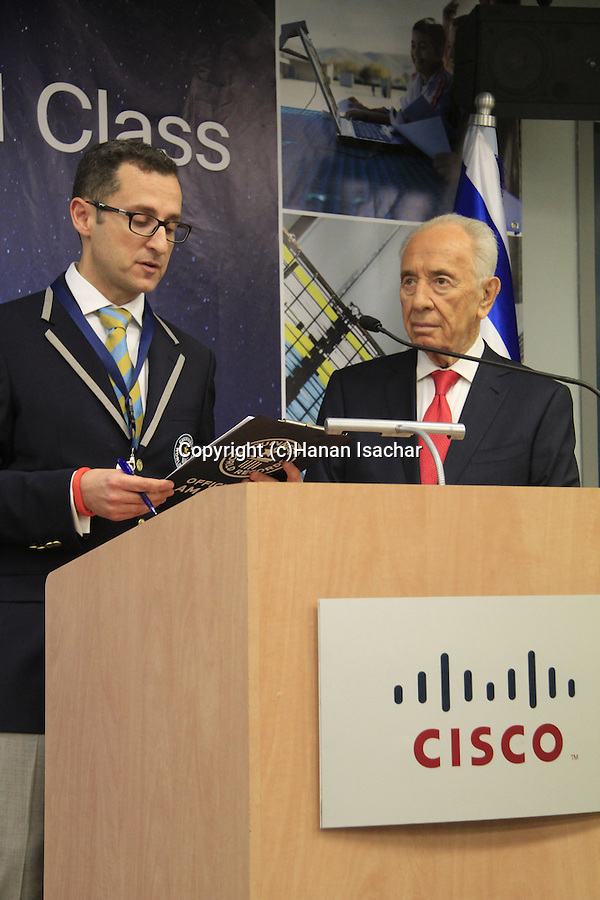 President Peres receives the Guinness World Record Holder card from Senior Vice President of Guinness World Records, Marco Frigatti