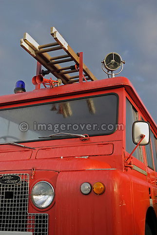 Historic 1960s Landrover Series 2a 109in Forward Control fire engine. Dunsfold Collection Open Day 2006, Dunsfold, England, UK. --- No releases available. Automotive trademarks are the proper, authorization may be needed for some uses. --- Information: Land Rover Series 2a 109in Forward Control fire engine belonging to the Dunsfold Collection; chassis number 23103850B, registration number YBF 505S, engine type 2.25 4-cyl petrol, gearbox type  4-speed manual..Vehicle History: A 109 Series 2a Forward Control with a difference. These odd vehicles were built by Charmichael, the famous fire appliance body builders and given the designation FT/6. The additon of another bulkhead and doors gave much needed crew and equipment space. The rear body, floor, fuel tank and seat box stay in their original places. The army and air force were amongst some of the many users. This vehicle was ex-army being released in 1975 and purchased by a copper wire factory where it was hardly used, having covered only 5900 miles until 1986 when it was retired..
