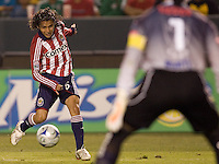 Chivas midfielder Francisco Mendoza (6) attempts a shot on Pachuca goalkeeper Miguel Calero (1) during a SuperLiga game. Pachuca CF defeated the Chivas USA 2-1 during the 1st round of the 2008 SuperLiga at Home Depot Center stadium, in Carson, California on Sunday, July 13, 2008.